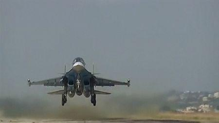 A still image shows a Russian jet taking off in Syria