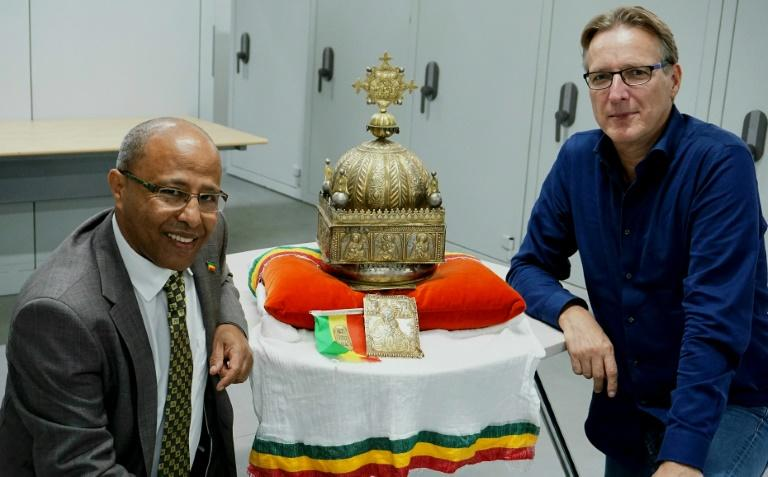 Dutch-Ethiopian Sirak Asfaw, left, and art detective Arthur Brand pose with the crown at a high-security facility in the Netherlands in September last year (AFP Photo/Jan HENNOP)