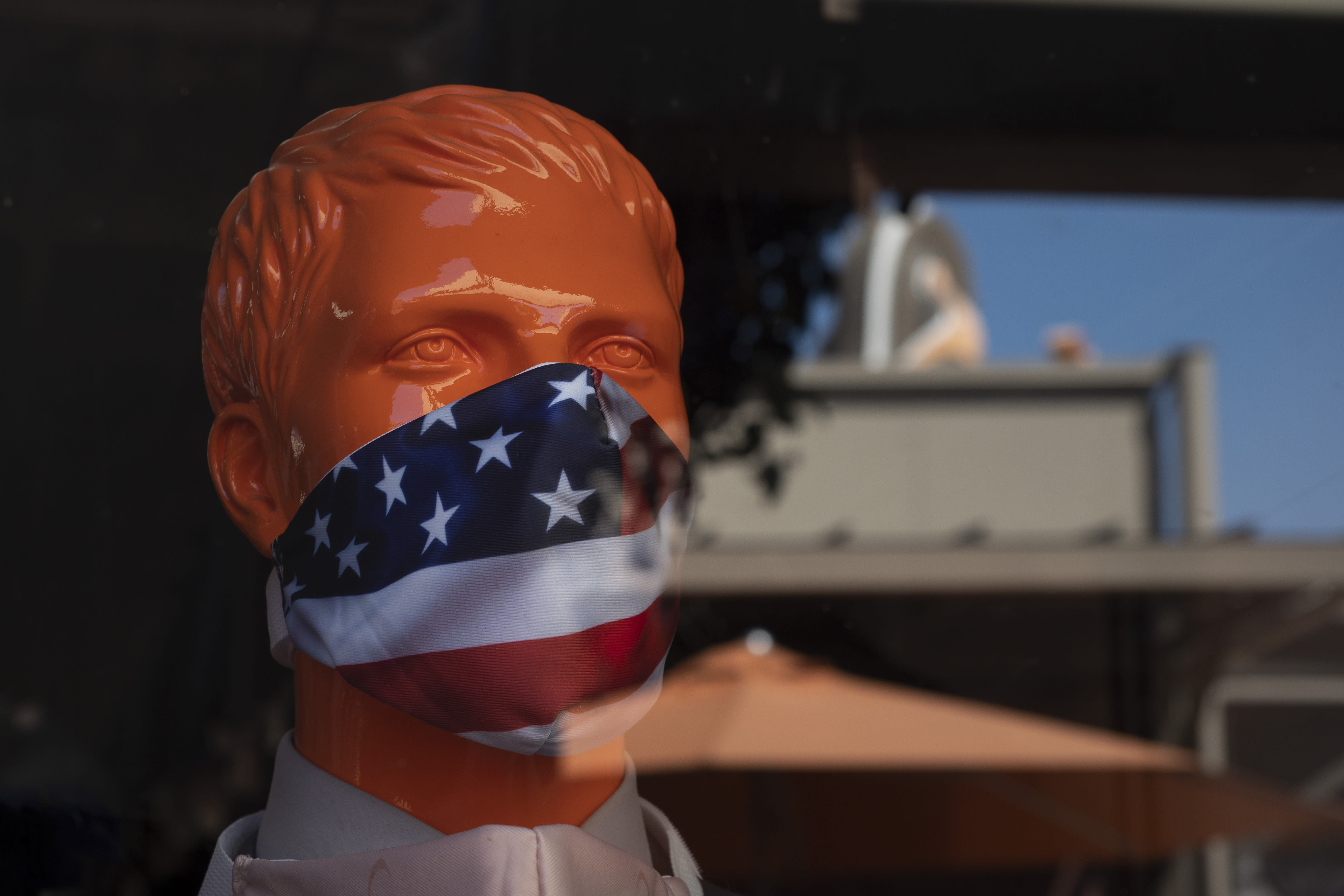 """A mannequin wears a face mask at the Citadel Outlets in Commerce, Calif., Thursday, July 2, 2020. California Gov. Gavin Newsom on Thursday urged Californians to turn to their """"better angels"""" and use common sense over the holiday weekend by wearing a mask and skipping traditional gatherings with family and friends. (AP Photo/Jae C. Hong)"""