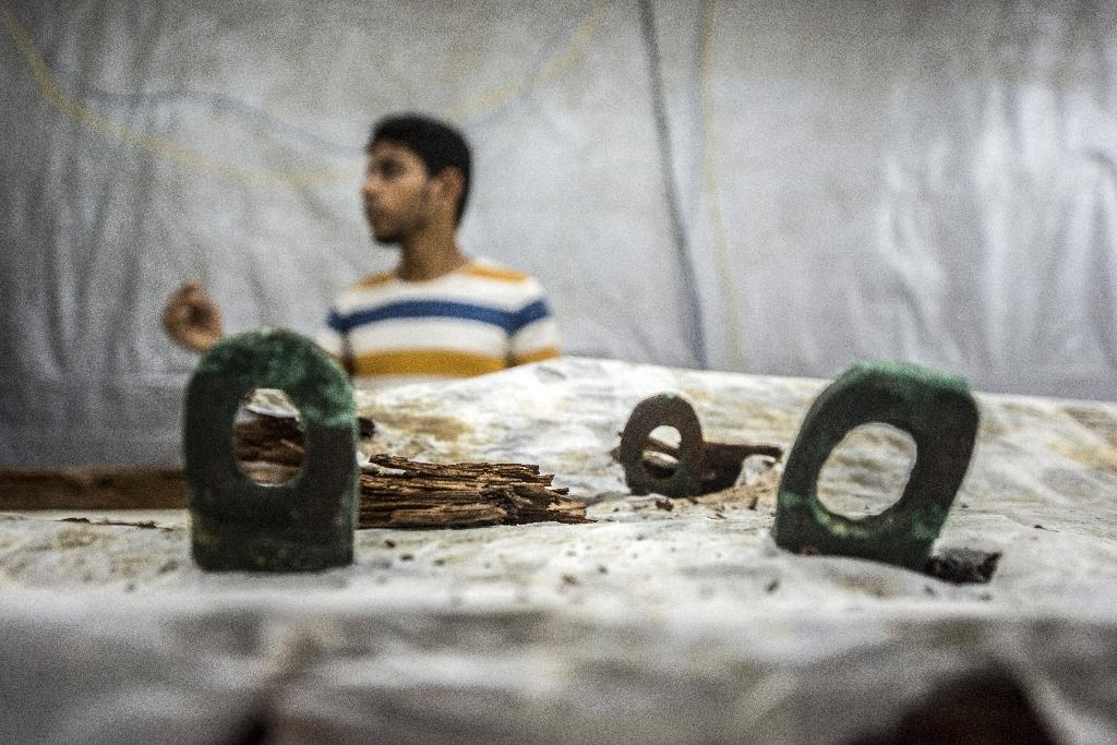 Metal pieces of the second solar boat of Pharaoh Khufu are seen at the restoration laboratory, located behind the Great Pyramid of Cheops on the Giza Plateau
