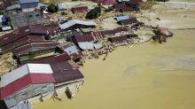 Indonesian flash floods kill at least 36