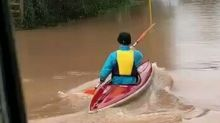 Kayaker Paddles Down Flooded Road in England Following Storm Dennis
