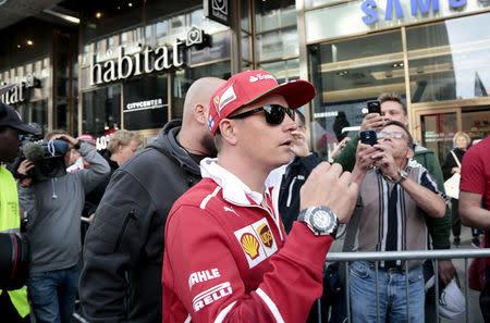 Finnish Formula One driver Kimi Raikkonen of Ferrari arrives to a media meeting of his sponsor Santander Bank in Helsinki