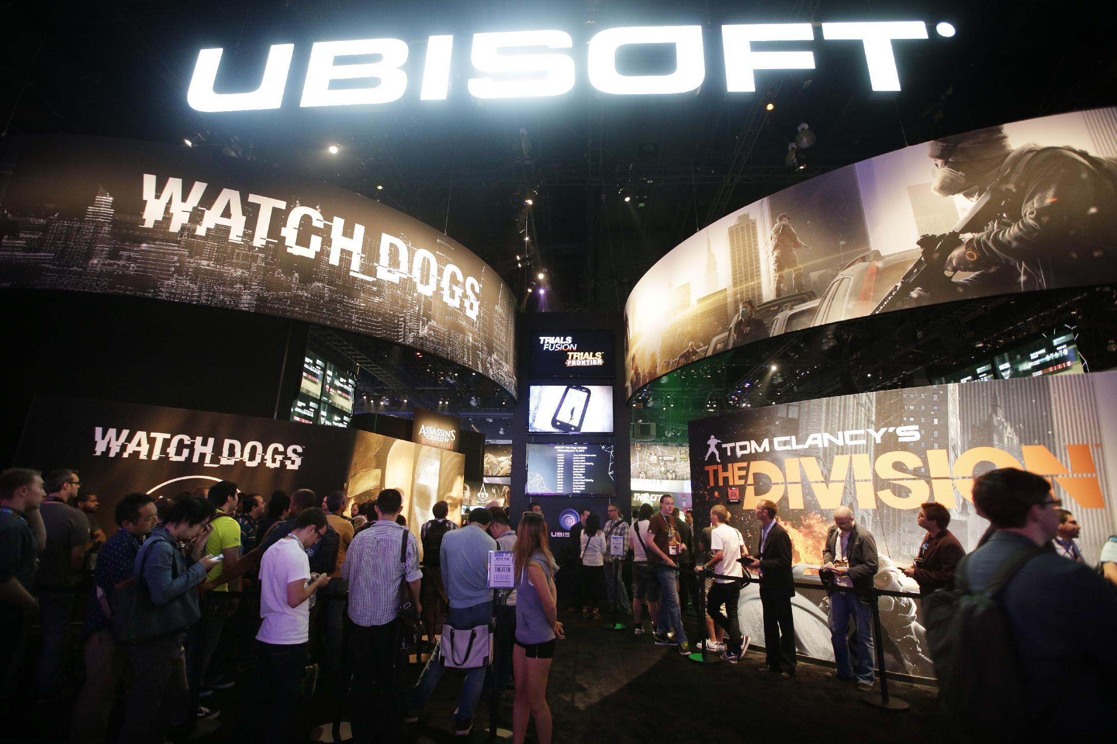 """This June 12, 2013 photo shows attendees waiting in line for the presentations on the video games, """"Watch Dogs"""" and """"Tom Clancy's The Division"""" at the Ubisoft booth during the Electronic Entertainment Expo in Los Angeles. Ubisoft's """"Watch Dogs"""" is about a super-hacker who can eavesdrop on phone conversations. It is among several games being hyped at the Electronic Entertainment Expo featuring ripped-from-the-headlines realness. (AP Photo/Jae C. Hong)"""