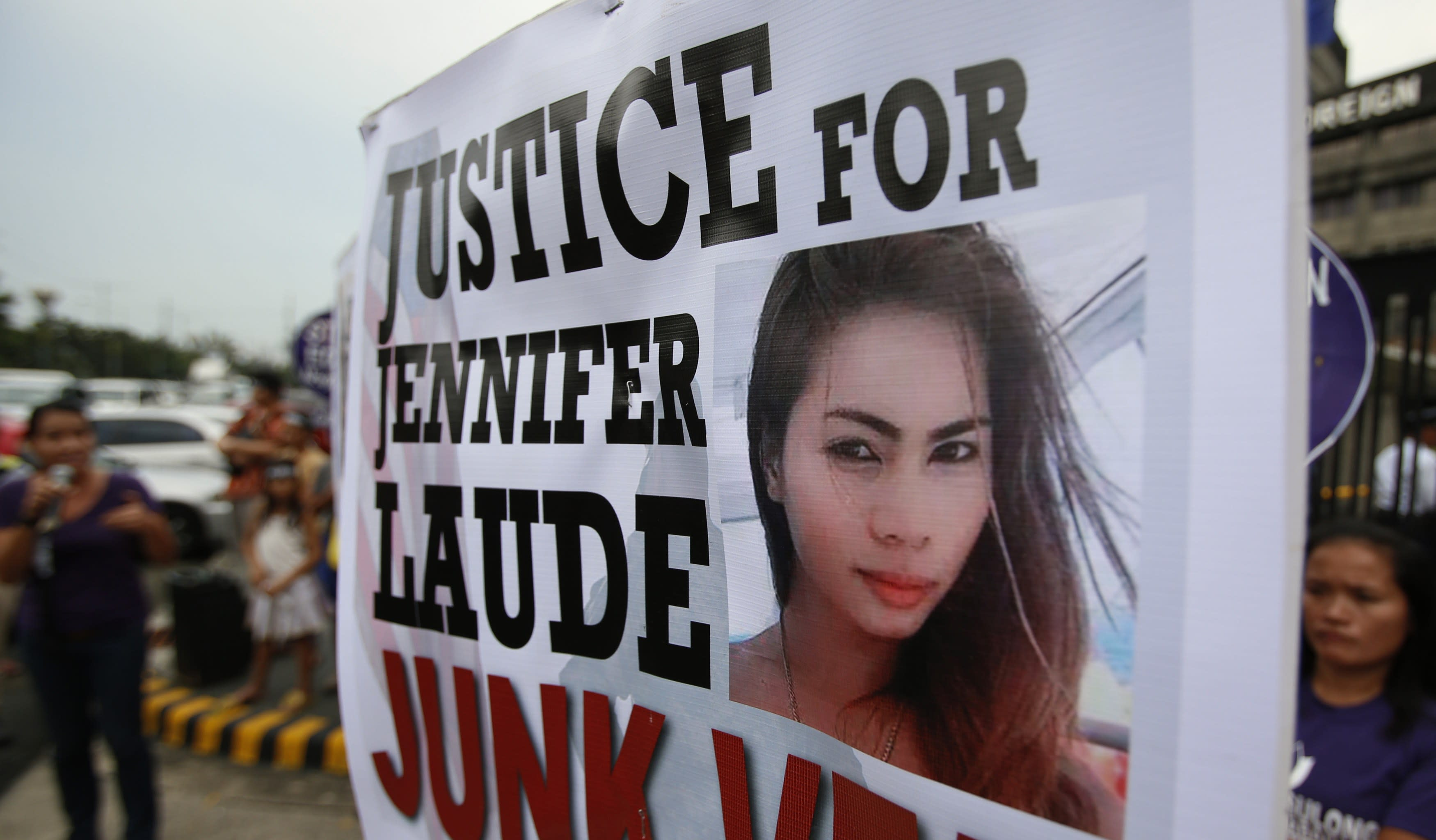 Protesters display a placard with a picture of slain 26-year-old Filipino transgender Jennifer Laude, during a rally outside the Department of Foreign Affairs in Manila October 15, 2014. The United States will keep custody of a Marine suspected in the murder of Jennifer Laude, whom he met in a bar, the head of the Philippine military said on Tuesday, and U.S. officials said a number of U.S. warships would remain in the country. REUTERS/Erik De Castro (PHILIPPINES - Tags: CRIME LAW POLITICS MILITARY)