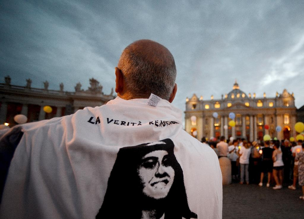 Emanuela Orlandi, whose face is seen on the t-shirt of a demonstrator in St. Peter's Square, was 15 when she vanished without a trace in Rome on June 22, 1983