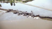 Crude oil leaks into floodwaters after train derails in Iowa