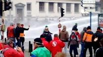 Police Fire Water Cannon at Protesters in Brussels