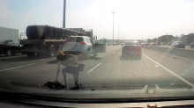 Highway 401 drama: Dash cam captures woman's fall from SUV in rush hour