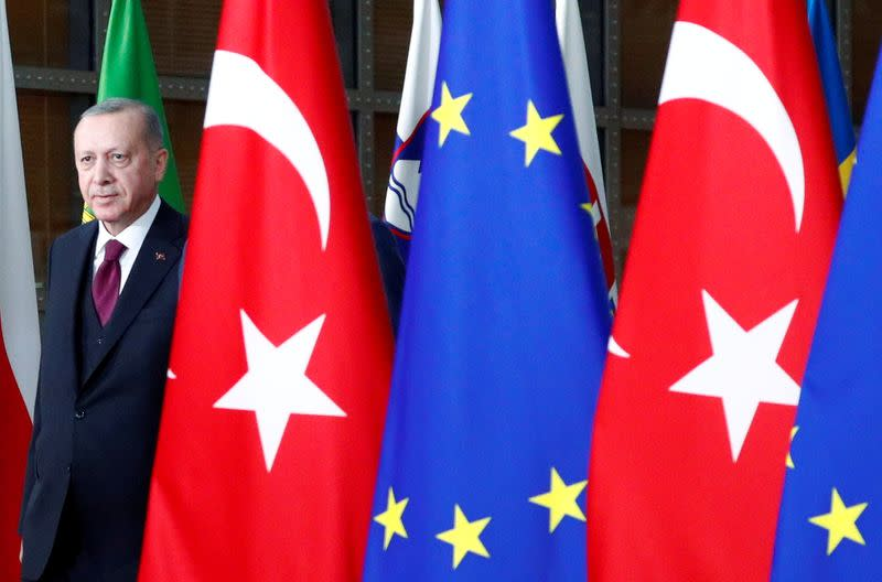 FILE PHOTO: Turkish President Tayyip Erdogan arrives for a meeting with EU Council President Charles Michel in Brussels