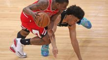 Young, White help Bulls top starter-less Bucks 118-112