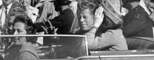 In this Nov. 22, 1963, file photo, President John F. Kennedy waves from his car in a motorcade in Dallas. (AP)