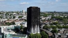 Police consider manslaughter charges over London blaze as thousands evacuated
