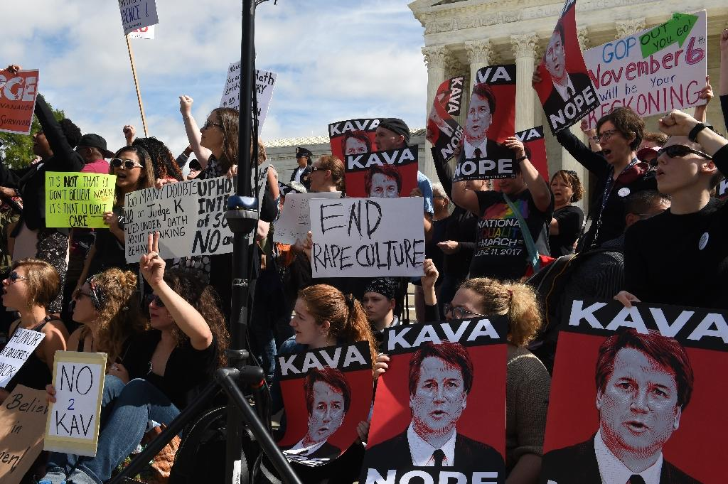 Activist demonstrate against Brett Kavanaugh, whose confirmation to the US Supreme Court -- which once seemed all but certain -- has been threatened by the #MeToo movement (AFP Photo/Eric BARADAT )