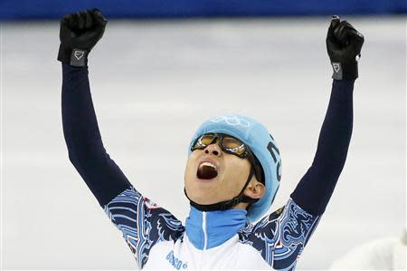 Victor An of Russia reacts as he wins the men's 1,000 metres short track speed skating final event at the Iceberg Skating Palace during the 2014 Sochi Winter Olympics