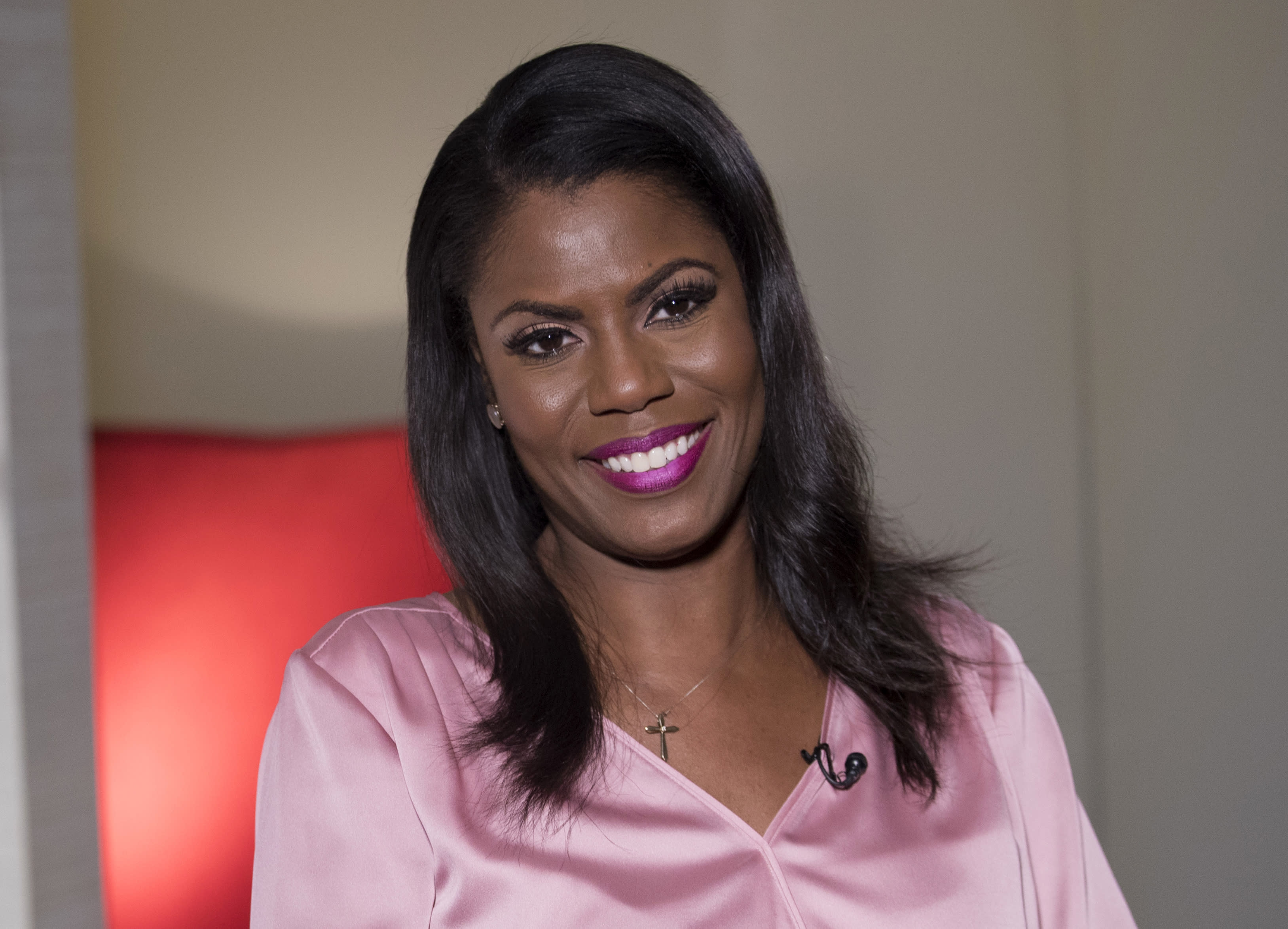"""FILE - In this Aug. 14, 2018, file photo former White House staffer Omarosa Manigault Newman smiles during an interview in New York. When President Donald Trump called porn actress Stormy Daniels """"horseface"""" on Twitter, he added to his long list of creative, some say misogynistic, descriptions for women. A look at how Trump's words, and his attitude, might play out three weeks before an election that features a record number of women candidates. (AP Photo/Mary Altaffer, File)"""
