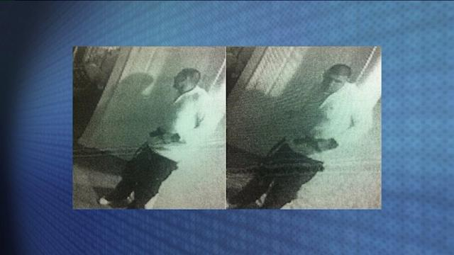 Surveillance Images Appear To Show Hernandez With Gun