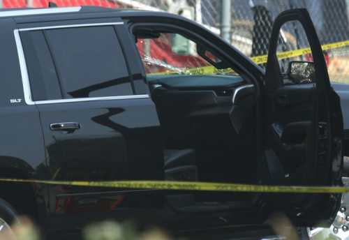 A black SUV with a hole on its windshield is seen outside the Eugene Simpson Stadium Park where House Majority Whip Steve Scales, R-La., was shot.
