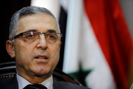 Syria's Minister of National Reconciliation Affairs Ali Haidar speaks during an interview with Reuters in his office in Damascus, Syria, March 19, 2018. REUTERS/Omar Sanadiki