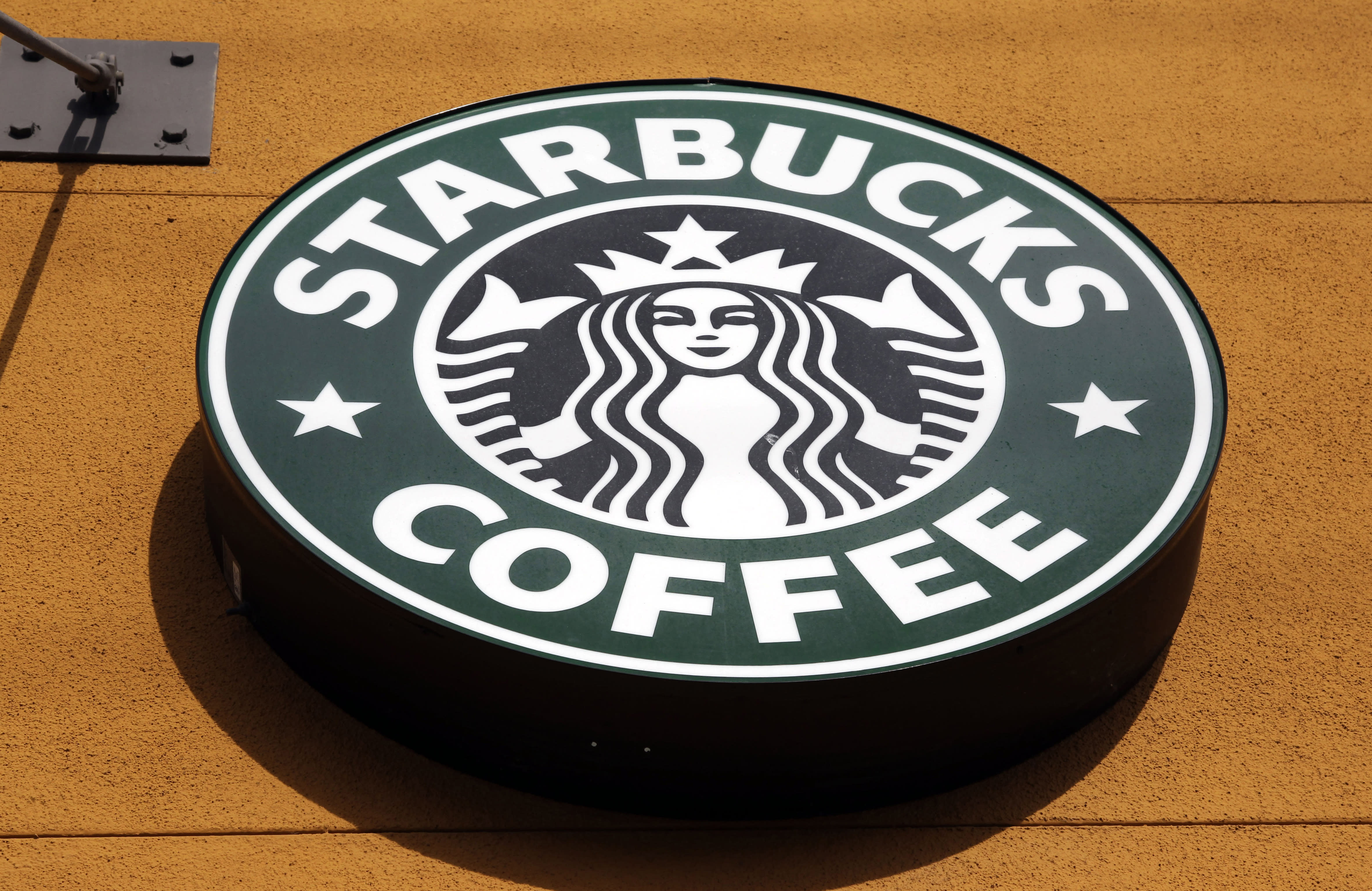 FILE - This Jan. 3, 2012 file photo shows the Starbucks Coffee logo in Mountain View, Calif. A growing number of U.S. companies are pledging to give workers time off to vote in the presidential election this November, an effort that's gaining steam despite the government's reluctance to make Election Day a federal holiday. Starbucks said Thursday it will give its 200,000 U.S. employees flexibility on Election Day, encouraging them to plan ahead with managers and schedule time to vote or volunteer at polling places. (AP Photo/Paul Sakuma, File)