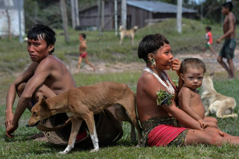 Indigenous Yanomami ethnic group members, seen waiting for COVID-19 tests at the 4th Special Frontier Platoon in Alto Alegre, Roraima state, Brazil, worry that going into cities for medical treatment will mean cutting them off from their culture (AFP Photo/NELSON ALMEIDA)