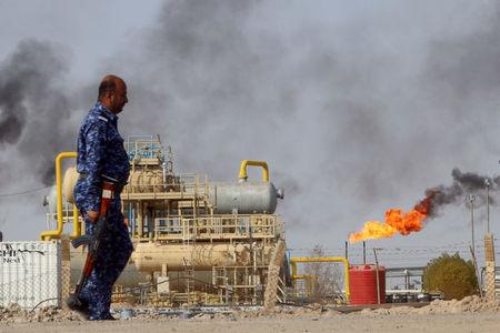 A member from the Oil Police Force is seen at Nahran Umran field norh of Basra