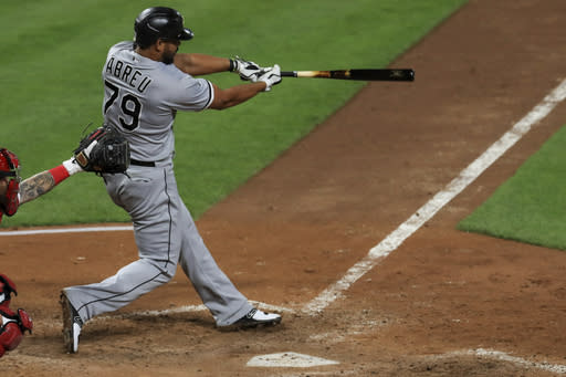 Chicago White Sox's Jose Abreu hits a solo home run in the eighth inning during a baseball game against the Cincinnati Reds in Cincinnati, Saturday, Sept. 19, 2020. (AP Photo/Aaron Doster)