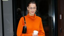 Bella Hadid Looks Ready for Halloween in an Orange Sweater Dress and Black Boots