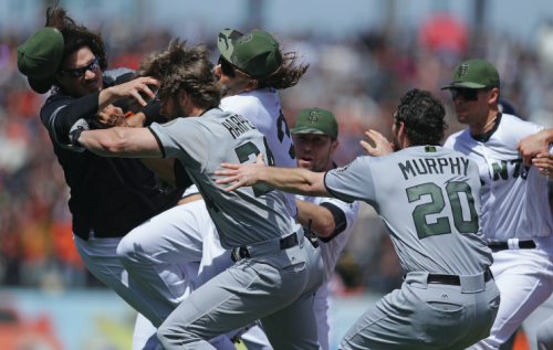 Michael Morse (left) right after his collision with teammate Jeff Samardzija. (AP Photo)