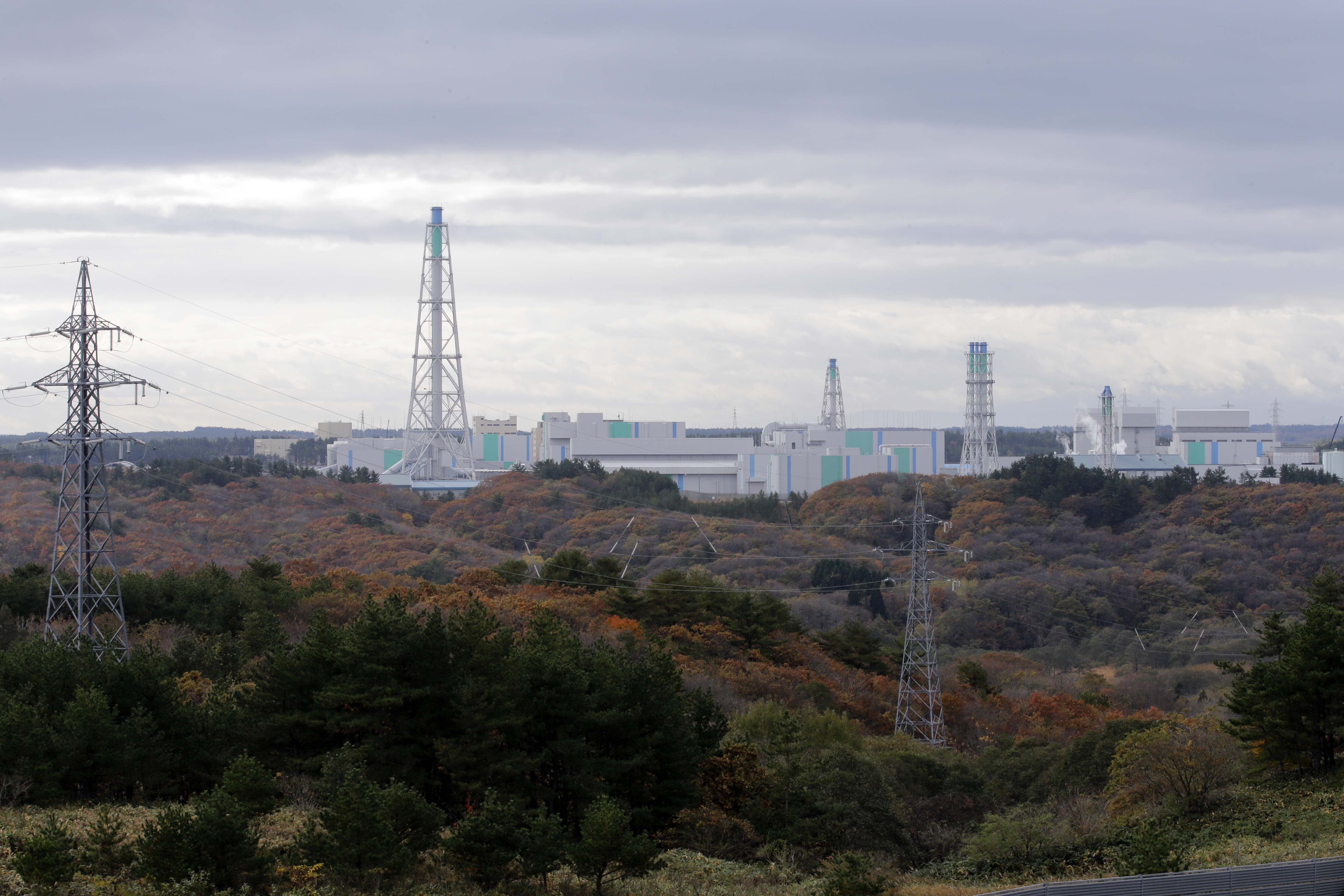 """In this Nov. 8, 2012 photo, the Rokkasho spent nuclear fuel reprocessing plant facilities, run by Japan Nuclear Fuel Ltd., stand in Rokkasho village in Aomori Prefecture, northern Japan. By hosting a high-tech facility that would convert spent fuel into a plutonium-uranium mix designed for the next generation of reactors, Rokkasho was supposed to provide fuel while minimizing nuclear waste storage problems. Those ambitions are falling apart because years of attempts to build a """"fast breeder"""" reactor, which would use the reprocessed fuel, appear to be ending in failure. (AP Photo/Koji Sasahara)"""
