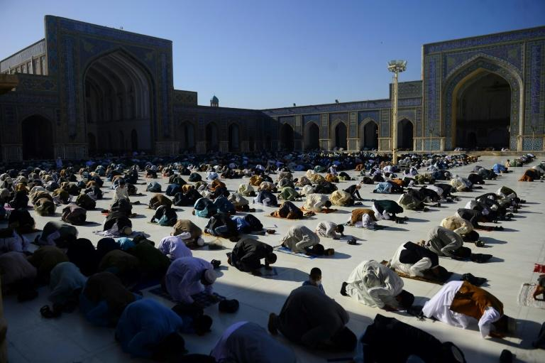 Muslim devotees offer prayers at the start of the Eid al-Fitr festival which marks the end of the Muslim holy month of Ramadan at the Jami mosque, in Herat (AFP Photo/HOSHANG HASHIMI)