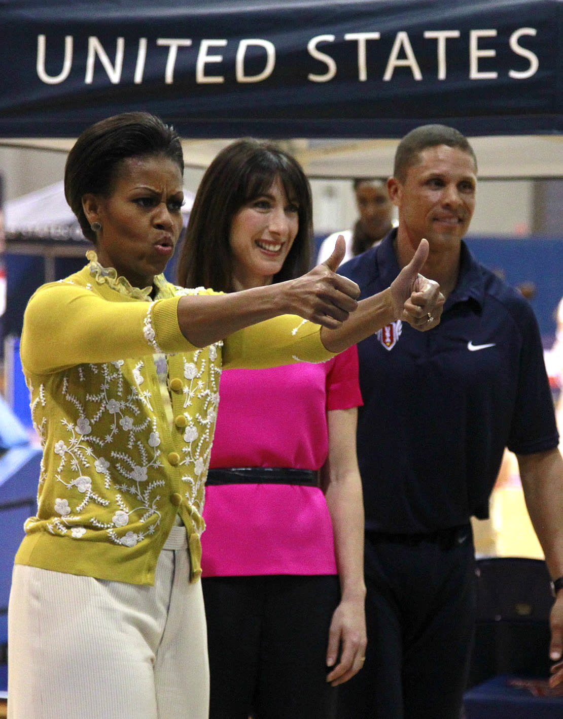 First lady Michelle Obama and Samantha Cameron, wife of British Primer Minister David Cameron, join with students participating in a mini-Olympics competition in celebration of the 2012 London Summer Olympics and Mrs. Obama's Let's Move! initiative, Tuesday, March 13, 2012 in Washington. At right is American decathlete and Olympic gold-medal winner Dan O'Brien. (AP Photo/Haraz N. Ghanbari)