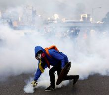 'End the injustice' pleads Venezuelan official's son over unrest