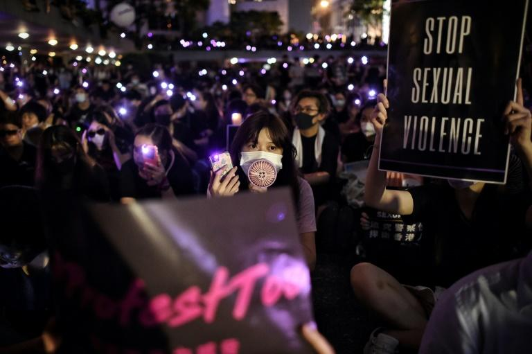 Thousands rallied against alleged police sexual violence, holding aloft purple lights in solidarity with abuse victims (AFP Photo/Lillian SUWANRUMPHA )