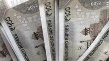 Rupee rises to 70.60 against dollar in early trade; Sensex, Nifty trading higher