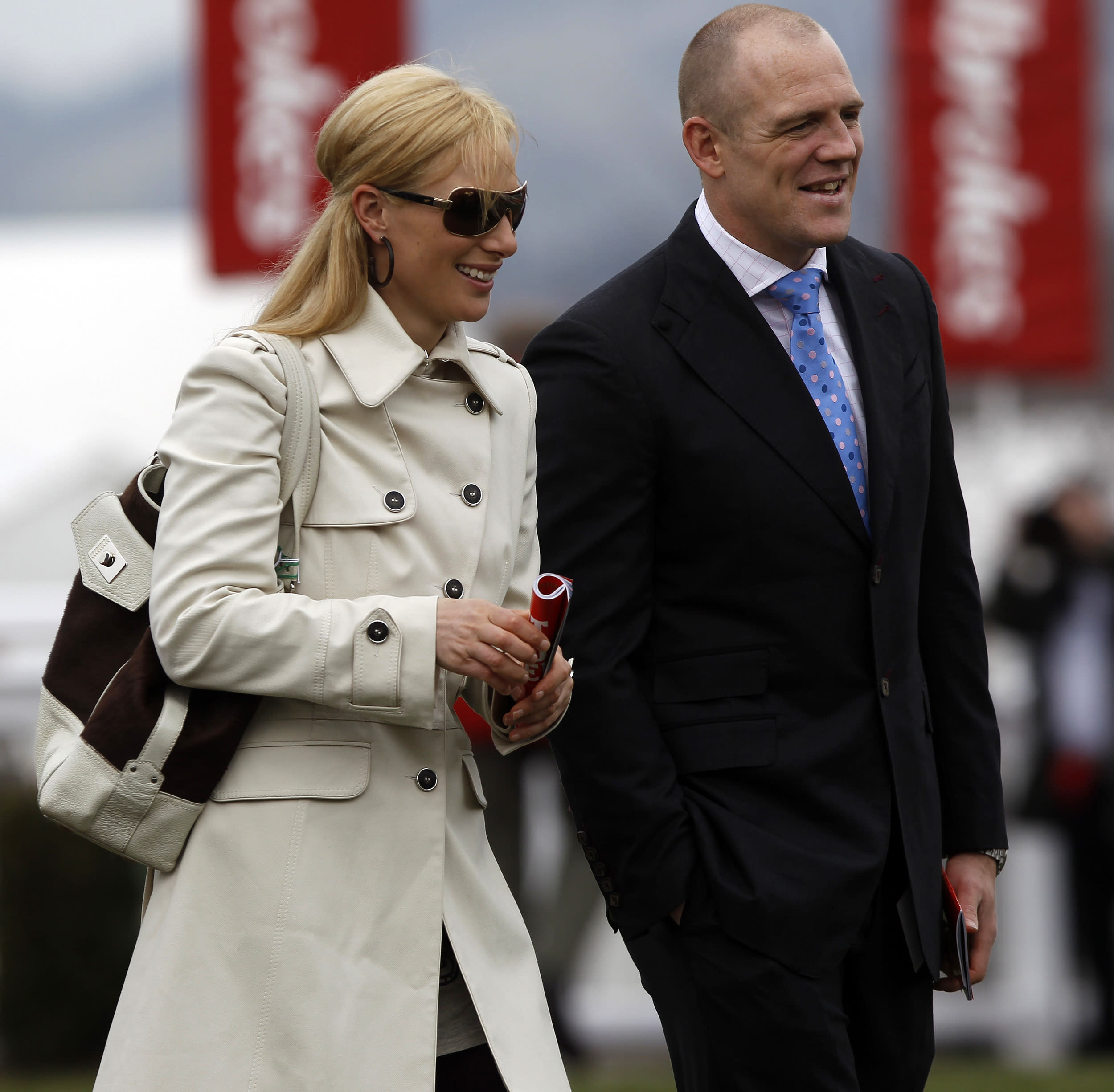 Britain's Zara Phillips (L) and her boyfriend England's rugby player Mike Tindall attend The Cheltenham Festival horse racing meet in Gloucestershire, western England March 18, 2010.   REUTERS/ Eddie Keogh (BRITAIN - Tags: SPORT HORSE RACING ROYALS)