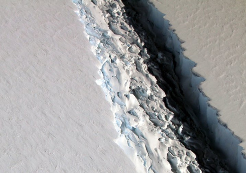 This Nov. 10, 2016 aerial photo released by NASA, shows a rift in the Antarctic Peninsula's Larsen C ice shelf. According to NASA, IceBridge scientists measured the Larsen C fracture to be about 70 miles long, more than 300 feet wide and about a third of a mile deep.