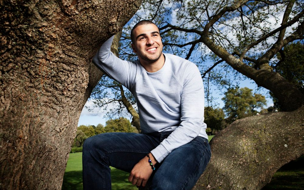 Dizzy heights: Adam Gemili, who won a gold medal at the World Athletics Championships this year, is pictured near Dartford Harriers Athletic Club in his home town - Rii Schroer