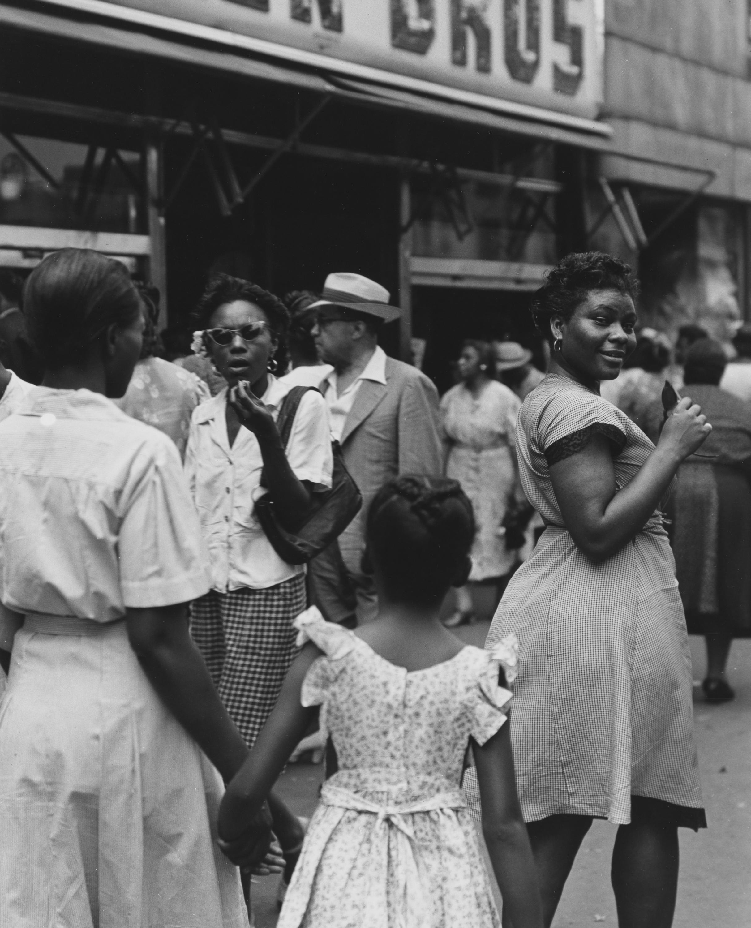 <p>Lady looking back at the camera, 125th Street. (© Todd Webb Archive) </p>