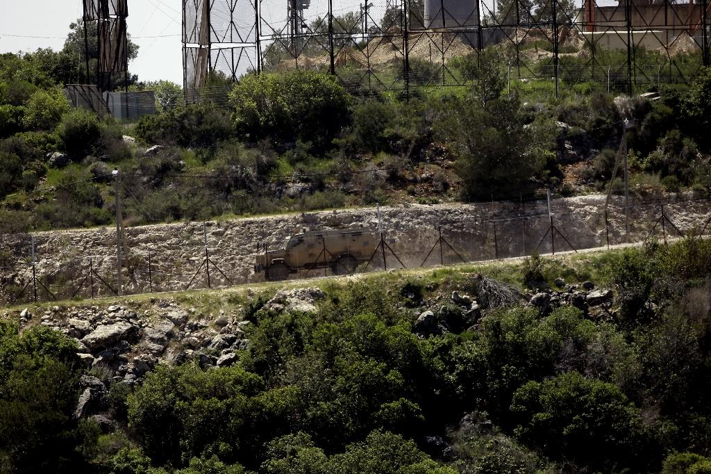 A picture taken from the Lebanese side of the border with Israel on the so-called Blue Line shows an Israeli army vehicle driving along a newly constructed road near the Israeli kibbutz of Hanita and Shlomi in April 2017