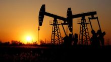 Oil hovers around six-month high as U.S. stocks rise