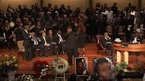 Mourners sing, clap and dance at funeral for slain Missouri teen