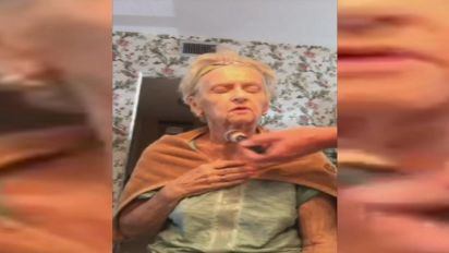 Makeup artist dolls up his mother to help her cope