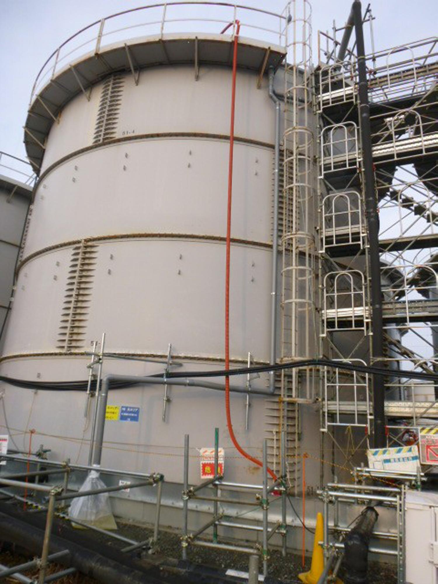 This photo released by Tokyo Electric Power Co. (TEPCO) shows a tank from which radioactive water leaked at Fukushima Dai-ichi nuclear power plant in Okuma, Fukushima Prefecture Thursday, Feb. 20, 2014. Highly radioactive water has overflowed from the storage tank, but the operator says it did not reach the Pacific Ocean. The operator, TEPCO said Thursday that the leak involved partially treated water from early in the crisis, meaning it was more toxic than previous leaks. Three reactors melted at the Fukushima Dai-ichi plant following the 2011 earthquake and tsunami, with radioactive water partially recycled and stored in more than 1,000 tanks. (AP Photo/Tokyo Electric Power Co. )