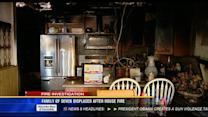 Family of seven displaced after house fire