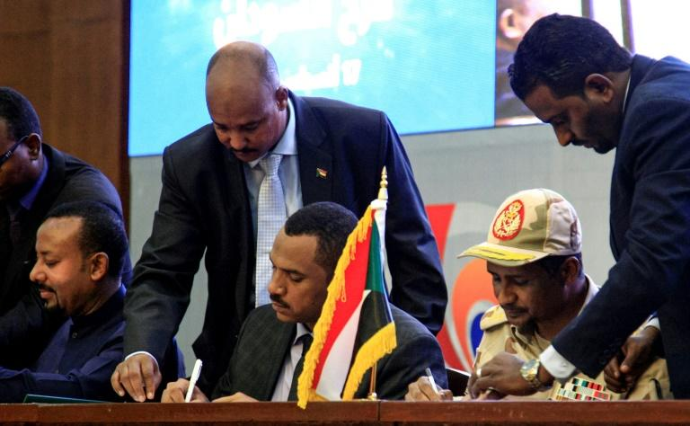 Sudan's protest movement signed a landmark power-sharing agreement with the ruling generals on Saturday but the promised transition to civilian rule has already got off to a bumpy start (AFP Photo/Ebrahim HAMID)