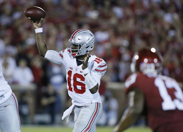 Ohio State QB J.T. Barrett threw for 154 yards and ran for 72 in a win over Oklahoma. (AP Photo/Sue Ogrocki)