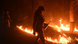 Firefighters battle California wildfires, bulldozer operator dies