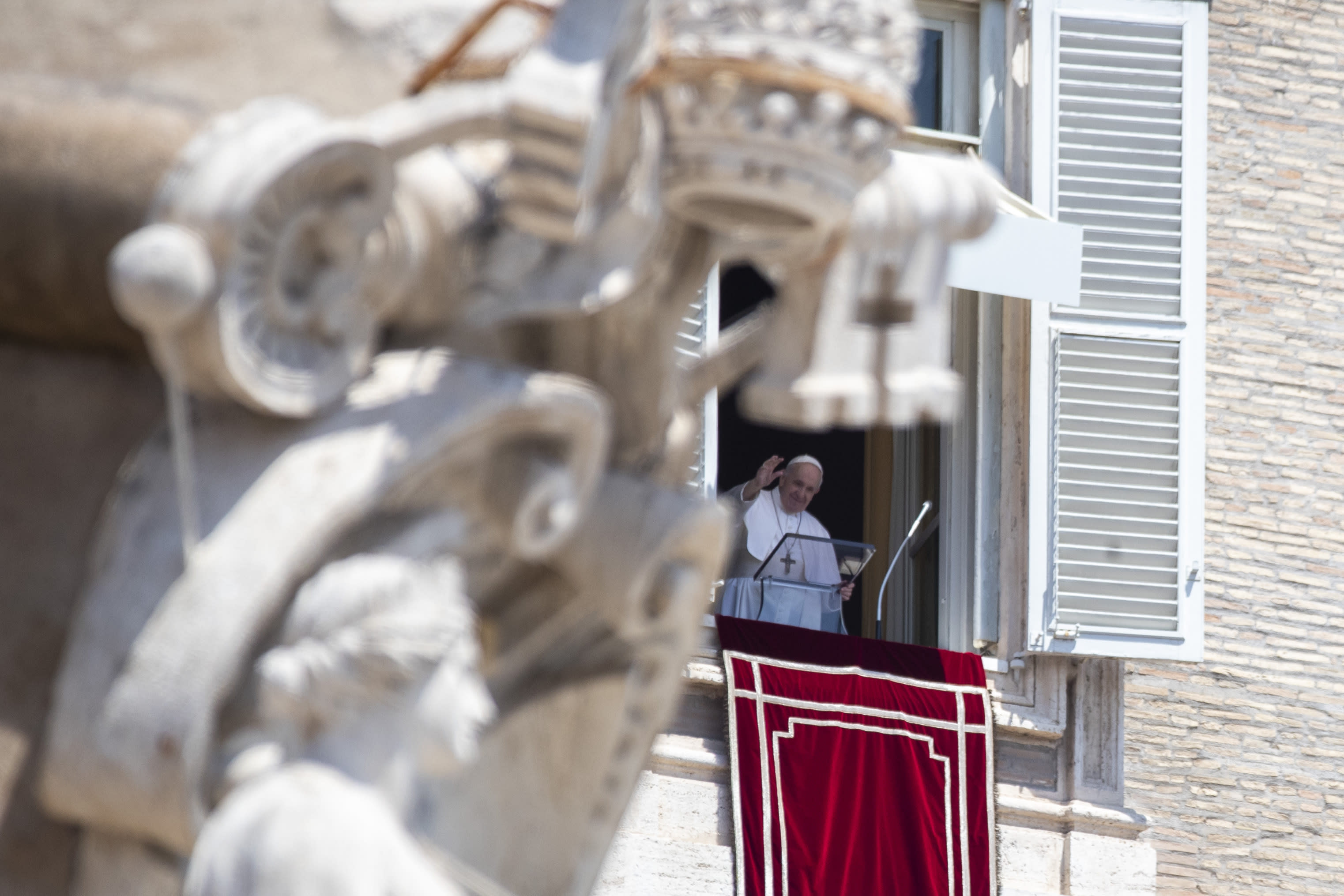 Pope Francis arrives for the Angelus prayer he delivers from the window of his studio overlooking St. Peter's Square at the Vatican, Sunday, July 12, 2020. (AP Photo/Alessandra Tarantino)