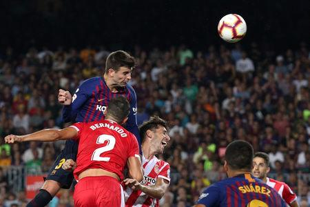 Pique rescues 10-man Barca to draw with Girona, Valencia continue to struggle